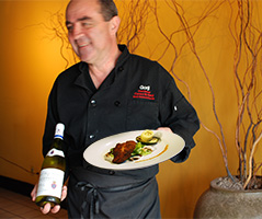 chef gorji serving wine in his upscale restaurant