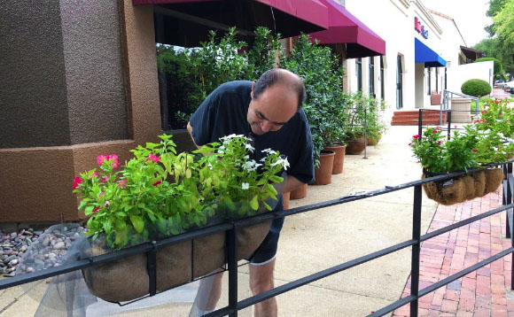 Voyage Dallas Magazine interview shows Chef Gorji outside Gorji restaurant